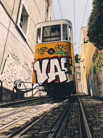 EyeEm Selects EyeEm Selects Graffiti Communication Transportation Railroad Track Text Outdoors Rail Transportation Day Built Structure Architecture Building Exterior No People Portugal Lisbon