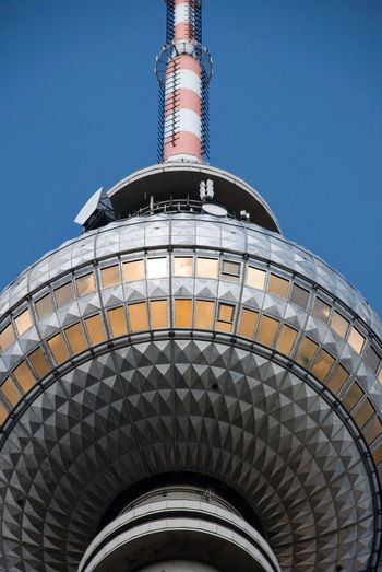 Tv tower on Alexanderplatz, Berlin Sphere Architecture TV Tower Landmark Germany Berlin Alexanderplatz Low Angle View Sky Clear Sky Built Structure Architecture No People Blue Tower Building Exterior Metal Tall - High Arts Culture And Entertainment Travel Destinations Tourism Travel Outdoors