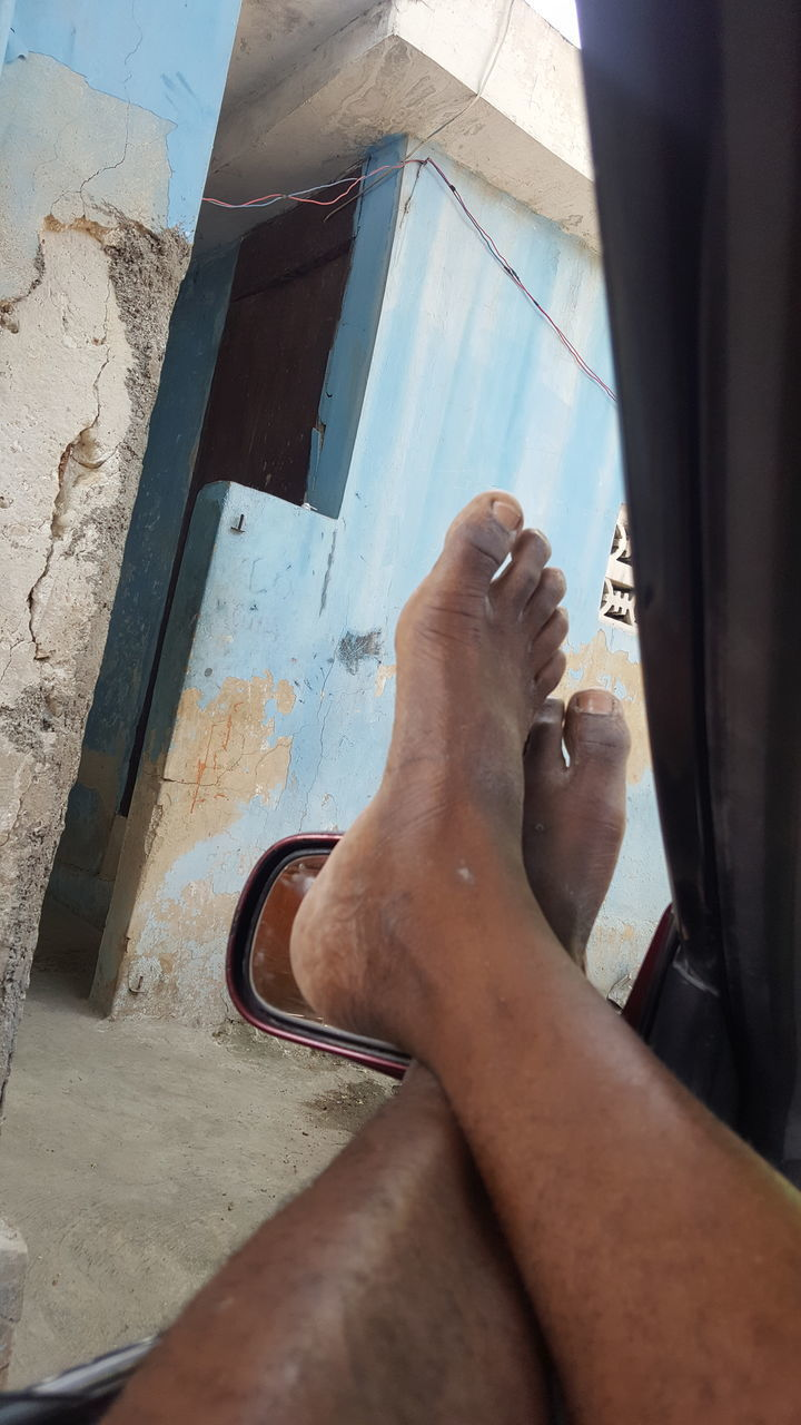 real people, human body part, human leg, body part, low section, one person, personal perspective, lifestyles, men, leisure activity, barefoot, human foot, window, relaxation, adult, day, high angle view, glass - material, outdoors, human limb