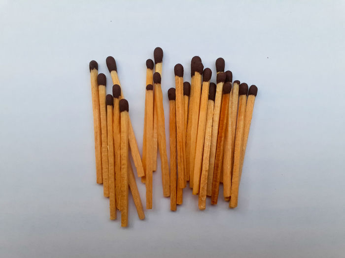 Directly above shot of matchsticks white background