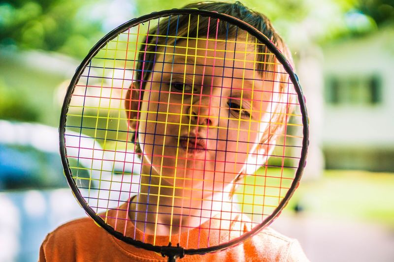 Net - Sports Equipment One Person Childhood Child People Teenager Tennis Sport Children Only Tennis Racket Day Concentration Outdoors Court Boys Tennis Ball One Boy Only Portrait Athlete Close-up