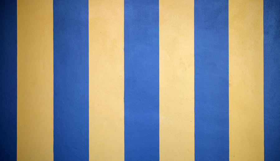 Full frame shot of blue yellow wall