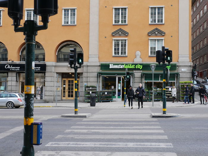street of Stockholm Cross Section Walkway Crossroad Crossing Building Incidental People Crosswalk Road Marking Mode Of Transportation Transportation Building Exterior Built Structure City Architecture Motor Vehicle City Life Street Road Sign Symbol Day Car Real People Outdoors Light