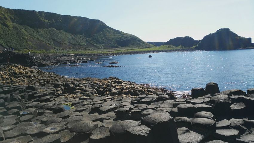 Sea Water No People Nature Sky Outdoors Day Travel Seascape Beauty In Nature Travel Destinations Travelphotography Tranquility Ireland Giant's Causeway Geological Formation Geology Sunlight
