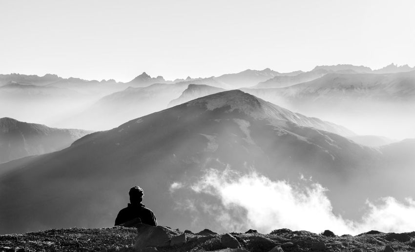 High Angle View Of Man Against Mountains During Foggy Weather