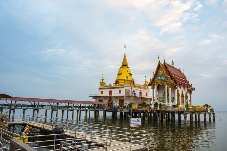 Wat Hong Thong Architecture Building Exterior Built Structure Cloud - Sky Day Gold Colored History Nature No People Outdoors Place Of Worship Religion Sky Spirituality Travel Destinations Water
