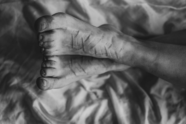 bound feet Adult barefoot Bed Body Part Care Close-up Finger Focus On Foreground Hand Human Body Part Human Finger Human Foot Human Hand Indoors  Jewelry Lifestyles One Person Real People Tattoo Unrecognizable Person Women