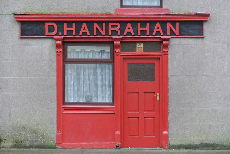 Building Exterior Closed Entrance Red Shopfront Small Text Window