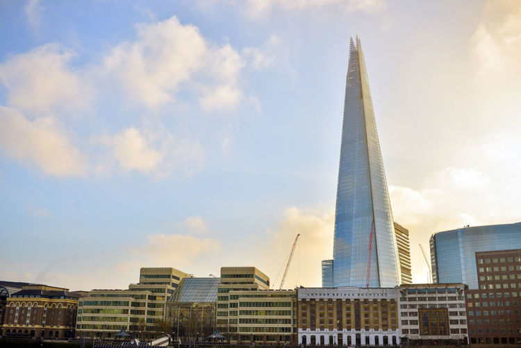 Low Angle View Of Buildings And The Shard Against Sky