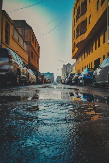 long road Streetphotography Street KSA Kingdom Of Saudi Arabia Al Khobar Travel Destinations Gulf Coast Road Drainage Teal Middle East King Water Reflection Building Exterior Architecture Outdoors Wet Sky