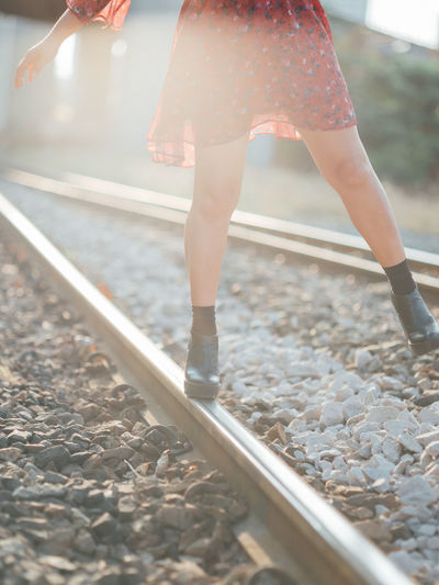 Rail Transportation Low Section Track Real People Railroad Track One Person Human Leg Body Part Human Body Part Women Day Lifestyles Leisure Activity Adult Standing Transportation Nature Walking Metal Outdoors Gravel Human Limb