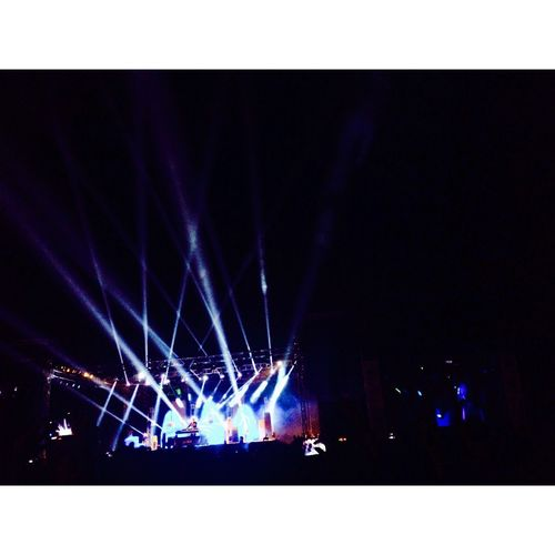 Night Illuminated Arts Culture And Entertainment Performance Stage - Performance Space Event Nightlife Stage Light Outdoors Popular Music Concert Spotlight Chainsmokers Concert Lights Darkness And Light Shotoniphone7 EyeEm Swag EyeEmNewHere ShotOnIphone Colours College Collegefest Collegelife
