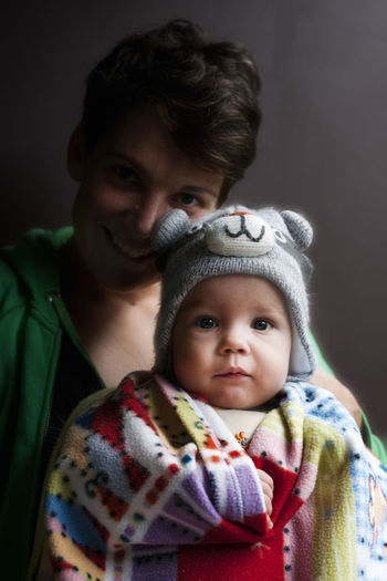 Portrait of mother with baby