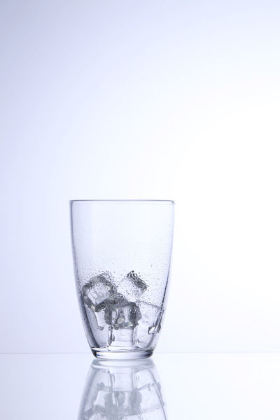 drinking glass with ice cube Isolated Clean Clear Close-up Cold Drink Cut Out Cut Out On White Dissolving Drink Drinking Glass Drinking Water Freshness Galss No People Object Refreshment Single Object Studio Shot Translucent Transparent White Background