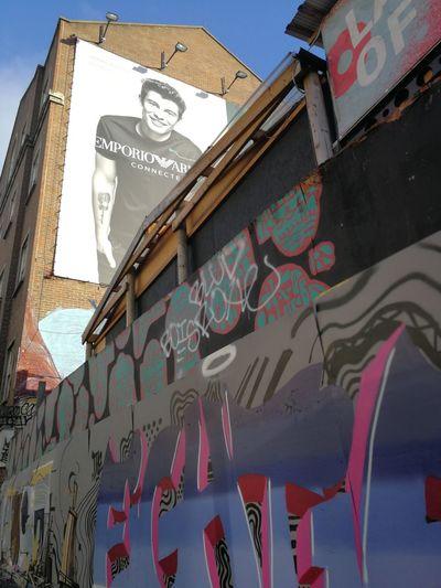 Architecture Building Exterior Day Outdoors No People City Shawn Mendes Graffiti Wall Art London Shoreditch, London Armani Emporio Armani Postcode Postcards