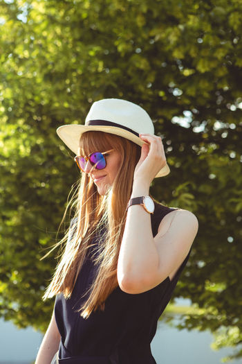Close up portrait of Young woman city lifestyle with Watch on her wrist Hairstyle One Person Long Hair Hair Real People Lifestyles Leisure Activity Young Women Blond Hair Focus On Foreground Fashion Tree Sunglasses Plant Day Women Glasses Waist Up Young Adult Adult Outdoors Beautiful Woman Teenager Fashion Blogger Watch Urban Urbanphotography City Ljubljana Slovenia Portrait Portrait Of A Woman Woman Casual Clothing Casual Look