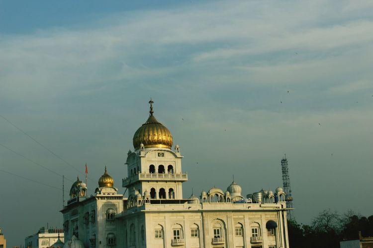 Low angle view of gurudwara bangla sahib against sky