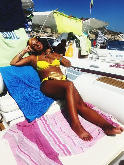 Woman sitting in boat
