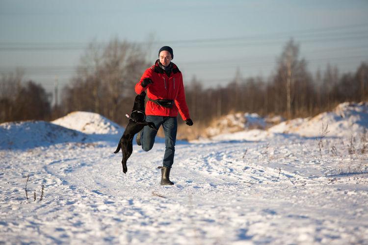 Full length of man on snow field