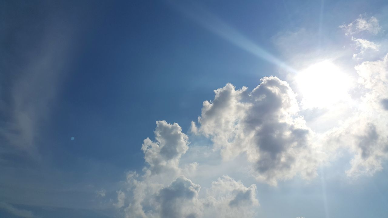 sky, nature, beauty in nature, cloud - sky, low angle view, tranquility, sunbeam, scenics, sky only, backgrounds, blue, day, no people, sunlight, tranquil scene, outdoors, full frame