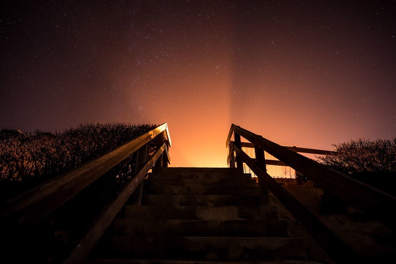 Low angle view of staircase against sky during sunset