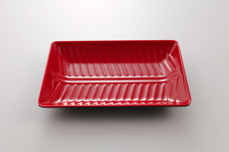 High angle view of red table against white background