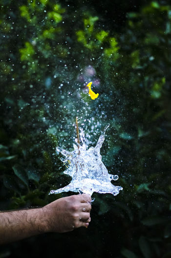 Close-Up Of Water Balloon Bursting In Hand