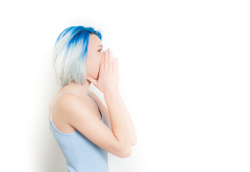Young hipster style girl profile screaming hand over face Amazed Astonished Blue Hair Copy Space Crying Expression Female Girl Hands Over Face Hipster Human Face Isolated One Person One Woman Only People Profile Screaming Teen Teenager Woman Young