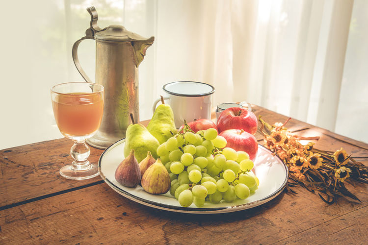 Healthy breakfast Autumn Autumn Morning Breakfast Fall Colors Rustic Apple - Fruit Choice Drink Drinking Glass Fall Fig Food Food And Drink Freshness Fruit Glass Grape Harvest Time Healthy Eating Household Equipment Indoors  No People Plate Refreshment Still Life Table Variation Wellbeing