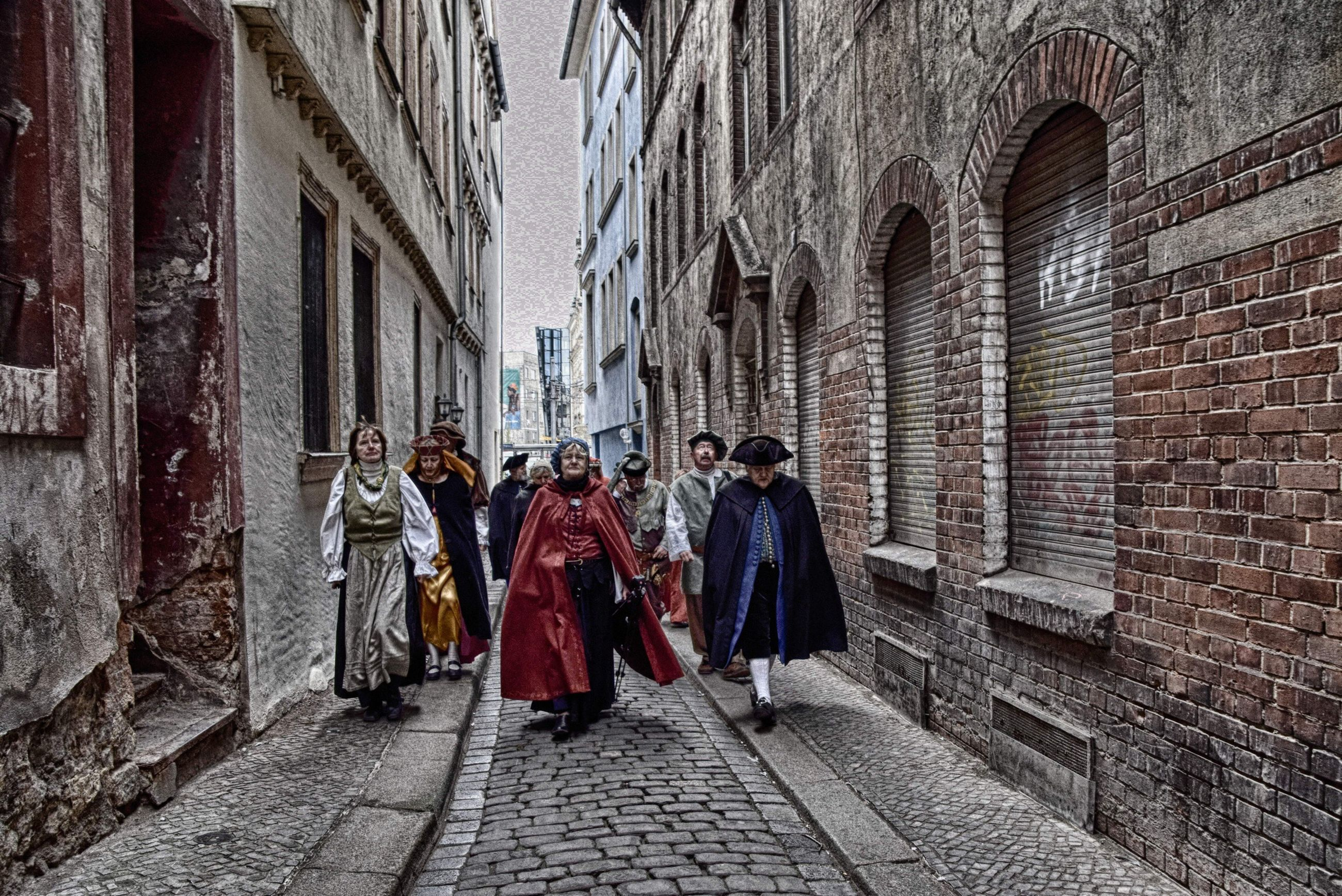 architecture, group of people, building exterior, full length, built structure, togetherness, city, clothing, women, adult, street, walking, people, day, brick, females, traditional clothing, real people, religion, building, outdoors, arch