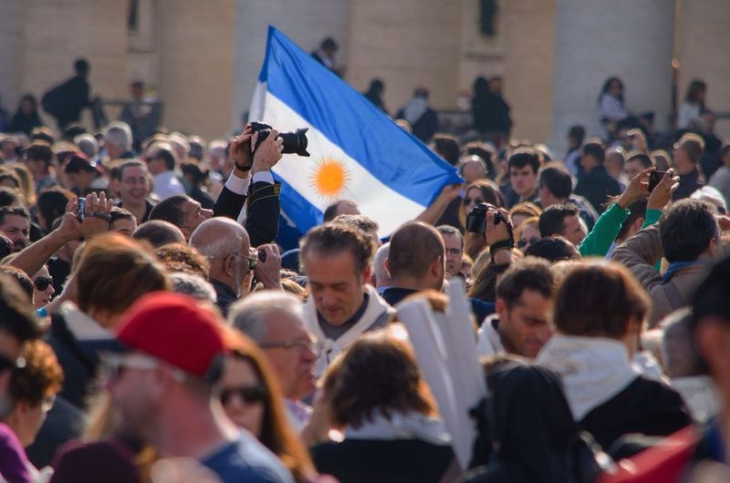 Argentinian flag in Vatican ceremony Celebration Crowd Day Enjoyment Event Focus On Foreground Fun Large Group Of People Leisure Activity Lifestyles Mixed Age Range Multi Colored Outdoors Person Selective Focus