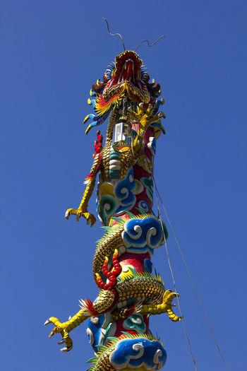 Dragon statue in Chinese temple Chinese Dragon Statue Dragon In Chinese Temple Animal Representation Art And Craft Belief Chinese Dragon Craft Creativity Dragon Dragon Statue Dragon Statues No People Ornate Outdoors Place Of Worship Religion Representation Sculpture Statue