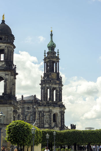 Low angle view of dresden frauenkirche against cloudy sky on sunny day