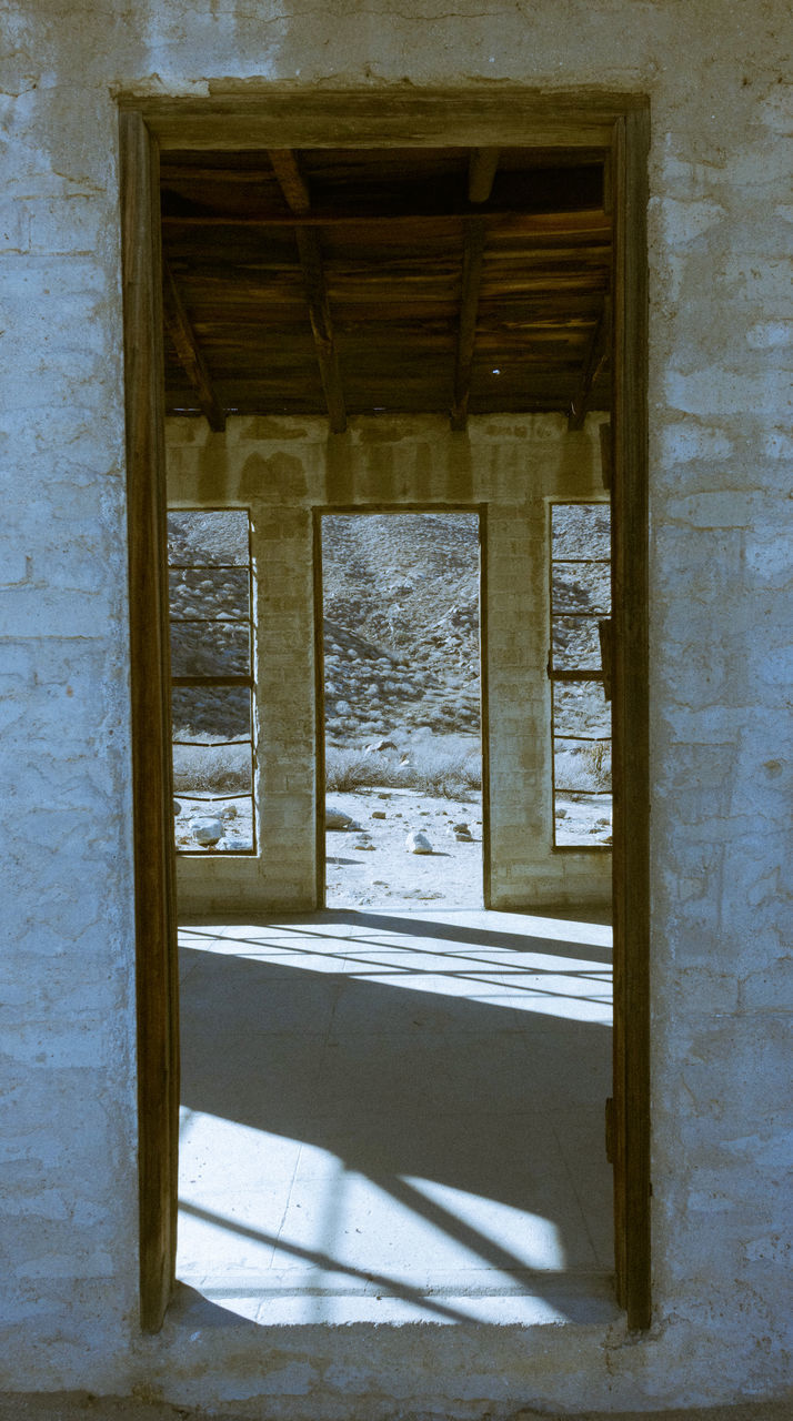 architecture, built structure, no people, day, building, indoors, old, abandoned, window, door, entrance, damaged, run-down, nature, history, deterioration, decline, sunlight, architectural column, ruined