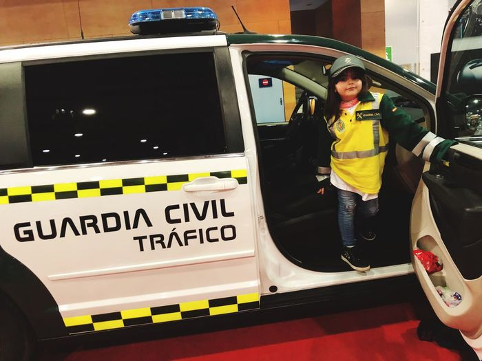 Portrait of girl standing in civil car