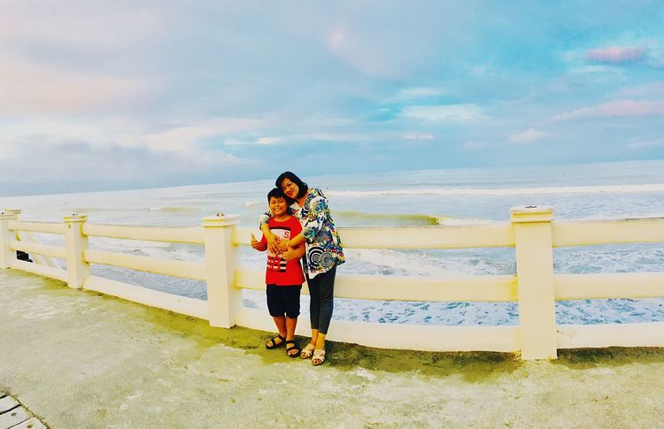 Sabang Beach Baler. My mom with my son first eyeem photo Be. Ready. Real People Happiness Day Water Smiling Standing Looking At Camera EyeEmNewHere