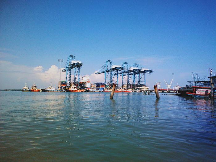 Commercial dock against blue sky