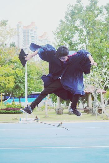 graduation Mid-air Exercising Youth Culture Outdoors Practicing Sport Motion Dedication Full Length Skill  Vitality Jumping Young Adult Strength Sports Training Agility Trust Individuality Tree Athlete First Eyeem Photo