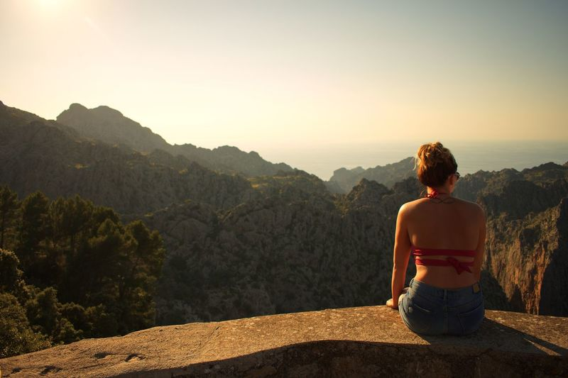 Take time to stop and take in the view Tramuntana Mallorca Rear View One Person Beauty In Nature Mountain Scenics - Nature Nature Leisure Activity Lifestyles Tranquility Real People Tranquil Scene Mountain Range Looking At View Non-urban Scene Outdoors Women Sunlight Adult Environment Sky Summer Road Tripping