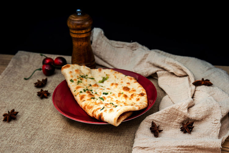 High angle view of naan in plate on table