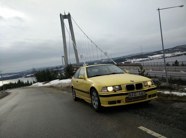 Högakusten Architecture Bmw Building Exterior Built Structure Car City Day Högakustenbron Land Vehicle Mode Of Transport No People Outdoors Road Sky Snow Street Transportation Weather Winter Yellow