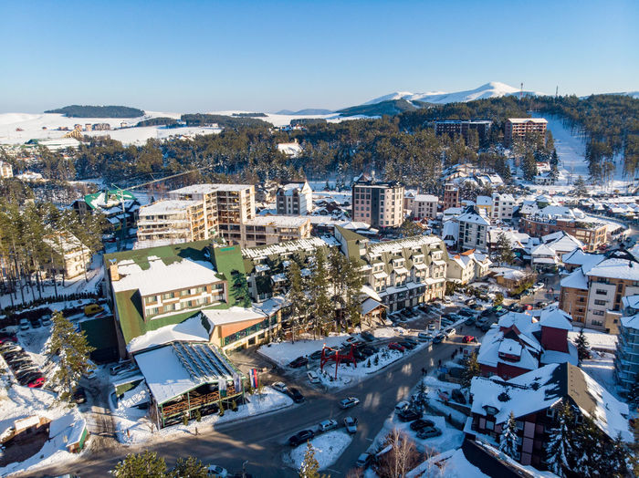 Building Exterior Architecture Built Structure City High Angle View Sky Building Winter Cityscape Nature Mountain Snow Residential District Day Crowd Cold Temperature Crowded Sunlight Blue Outdoors TOWNSCAPE