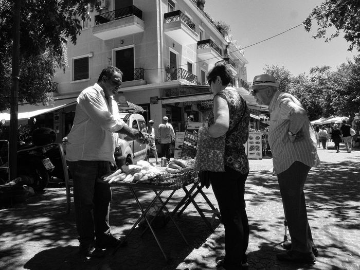 What is that thing doing again? Streetphotography Streetphoto_bw Street Photography Surprise Old Man Street Seller