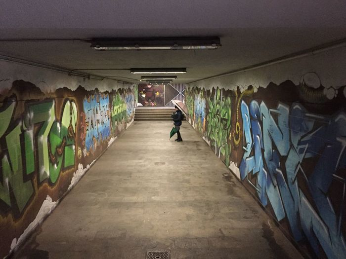 One Person Full Length Indoors  Real People Architecture Graffiti Wall - Building Feature Diminishing Perspective Illuminated Day Casual Clothing Walking Lifestyles