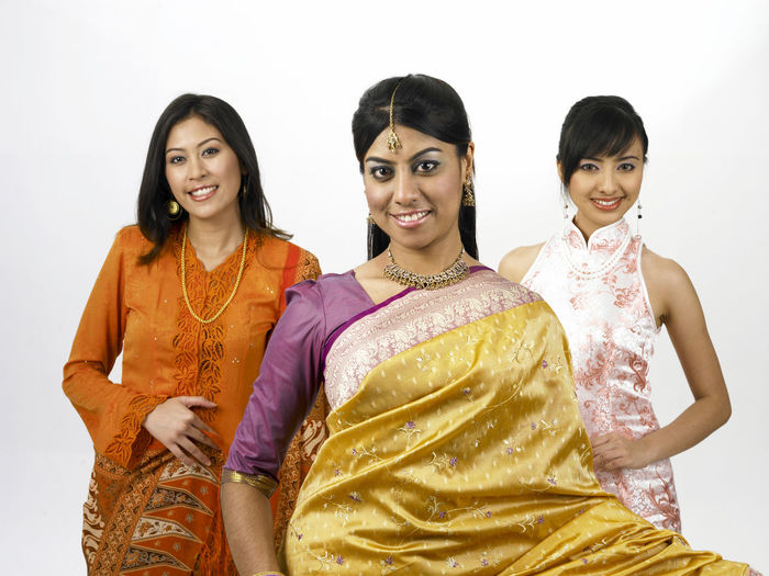 malaysia young woman in traditional costumes Friends Indian Traditional Clothing Baju Kebaya Beautiful Woman Bubby Cheongsam Chinese Friendship Group Of People Happiness Harmony Malay Ethnicity Malaysian Merdeka Mixed Race Multi Racial Racial Sari Smiling Together Togetherness United White Background Women