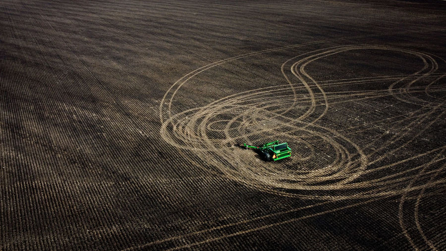 High angle view of farm equipment in field