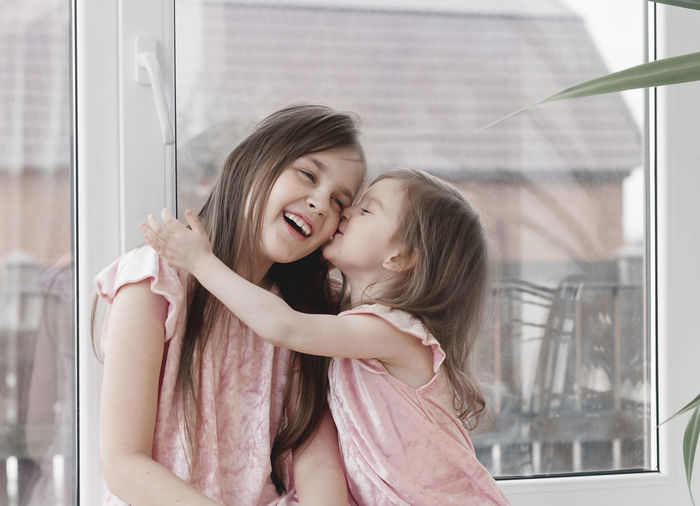Mother and girl smiling
