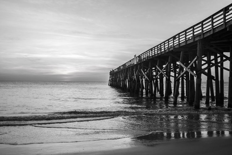 Flagler Beach, Florida Flagler Pier Architectural Column Architecture Beach Beauty In Nature Black And White Photography Built Structure Cloud - Sky Day Florida Horizon Horizon Over Water Idyllic Land Nature No People Outdoors Pier Scenics - Nature Sea Sky Sunrise Tranquil Scene Tranquility Water Wooden Post