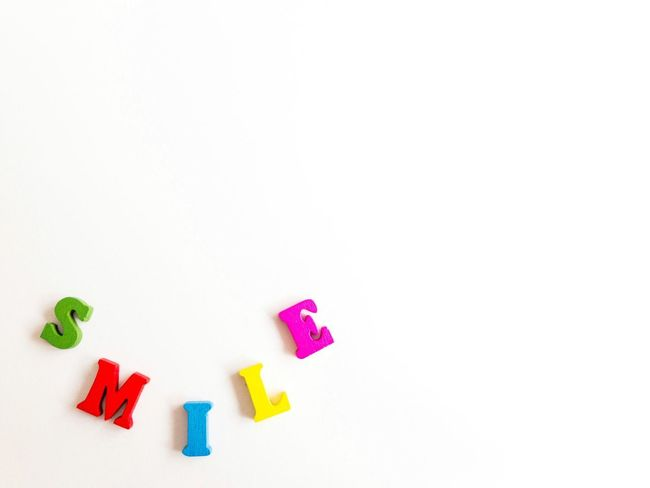 Capital Letter Smiling Written Write Lettering Form Comunication Text Motivation Optimism Optimistic Happiness Happy EyeEm Best Shots EyeEmNewHere Conceptual Concept Smile Wooden Letters Color Words Word Letters Copy Space White Background Childhood Studio Shot Multi Colored Variation