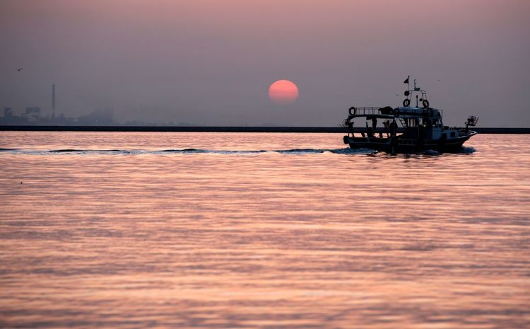 Fishingboat Water Sea Sky Nautical Vessel Transportation Sunset Beauty In Nature Nature Mode Of Transportation Scenics - Nature Dusk Horizon Over Water Horizon Ship Outdoors No People Cloud - Sky Environment Land Passenger Craft Adventures In The City